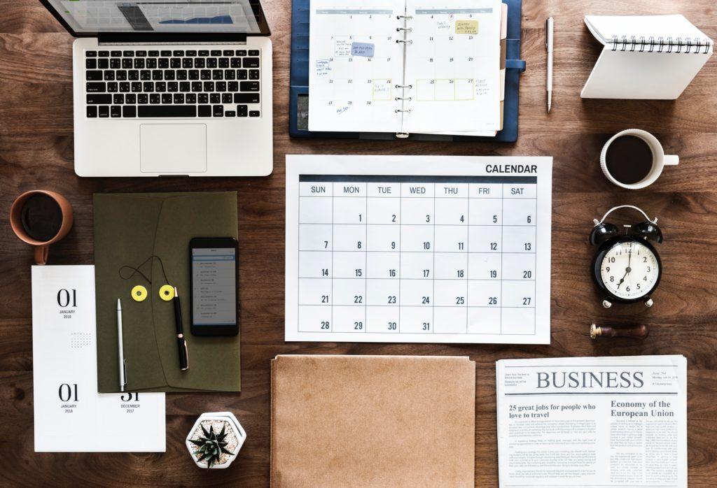 laptop, calendar, cellular phone, clock, newspaper, organizer